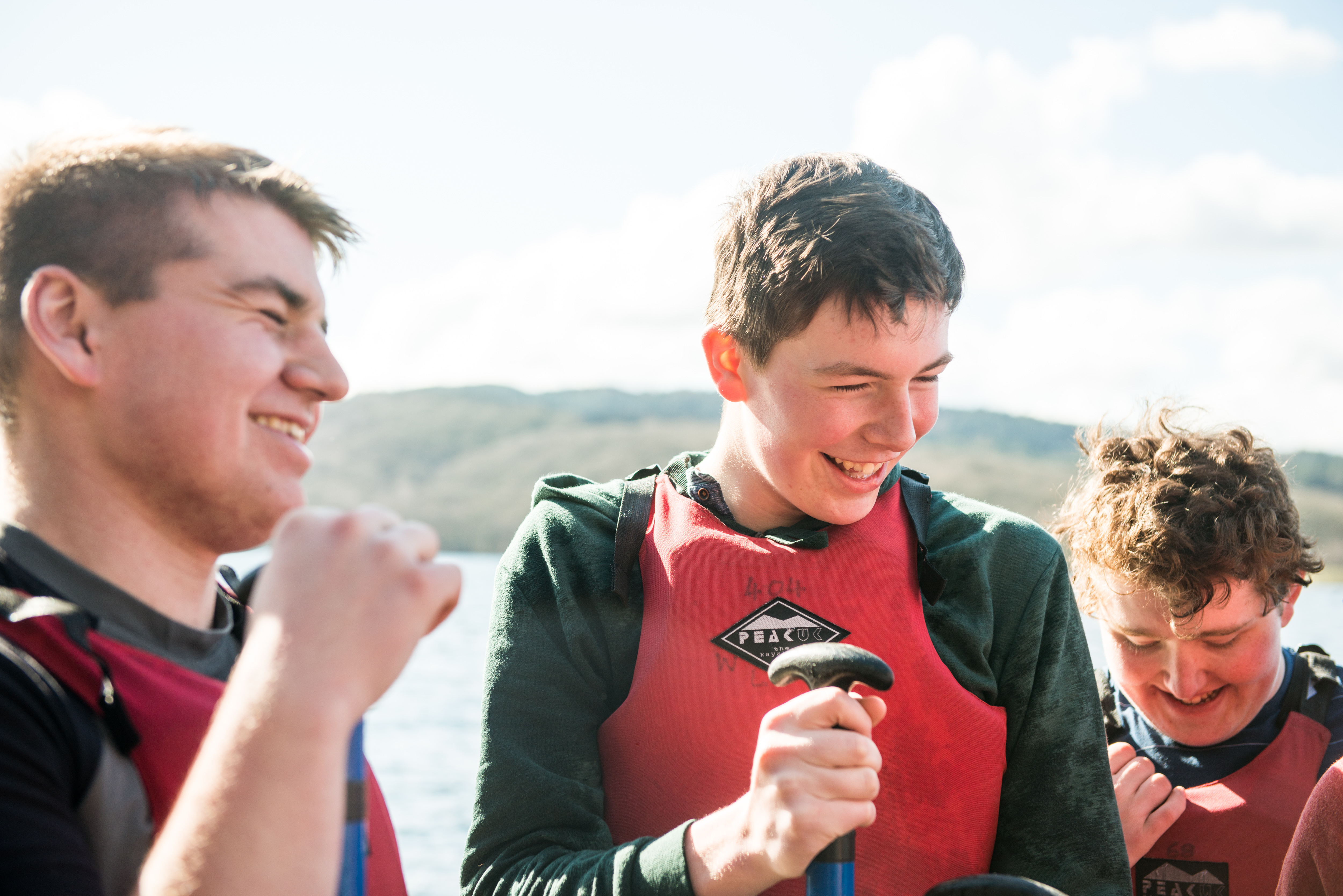scouts-in-life-jackets-chatting-jpg